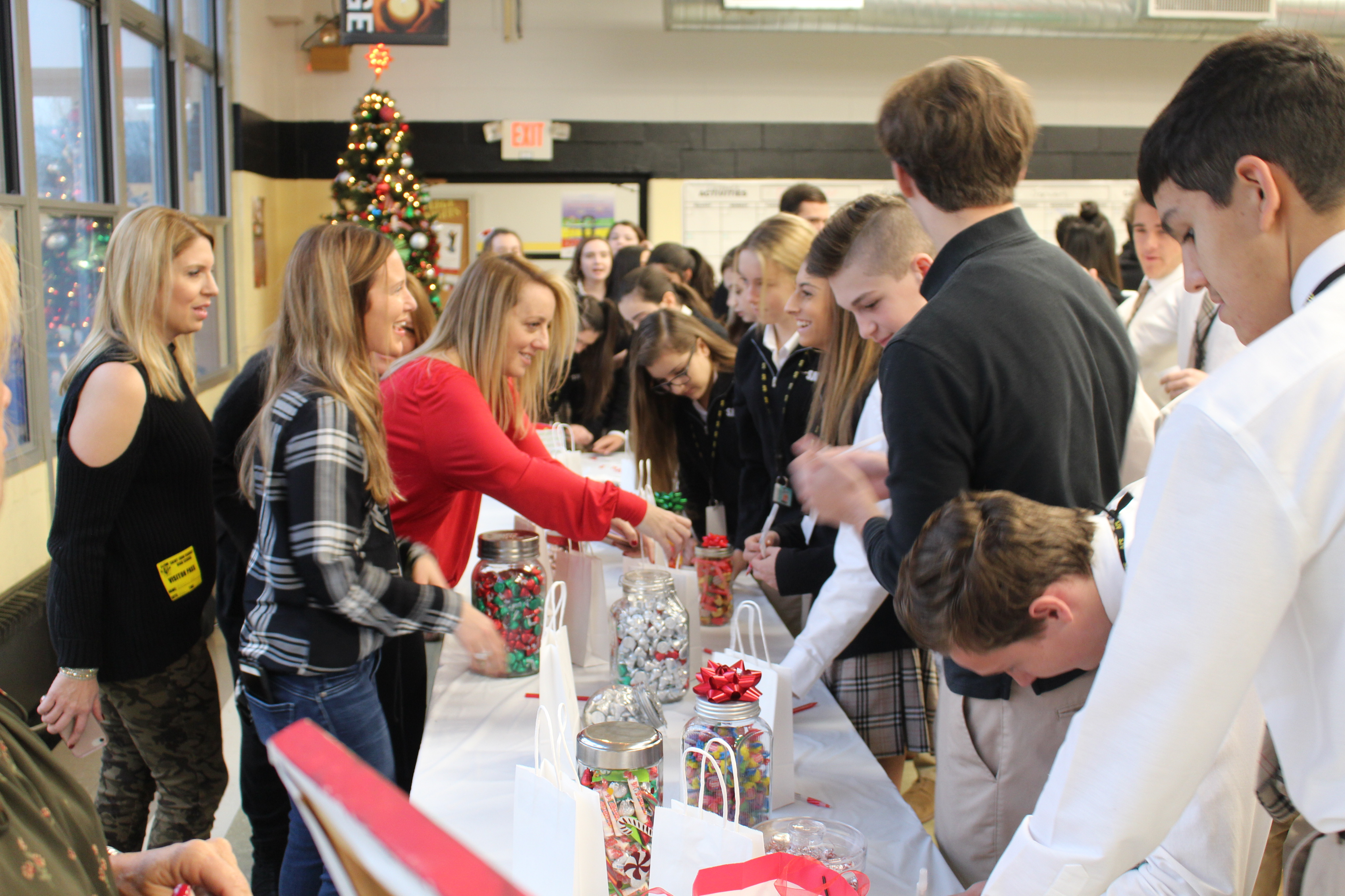 PTA Members Passing Out Treats at Christmas Event