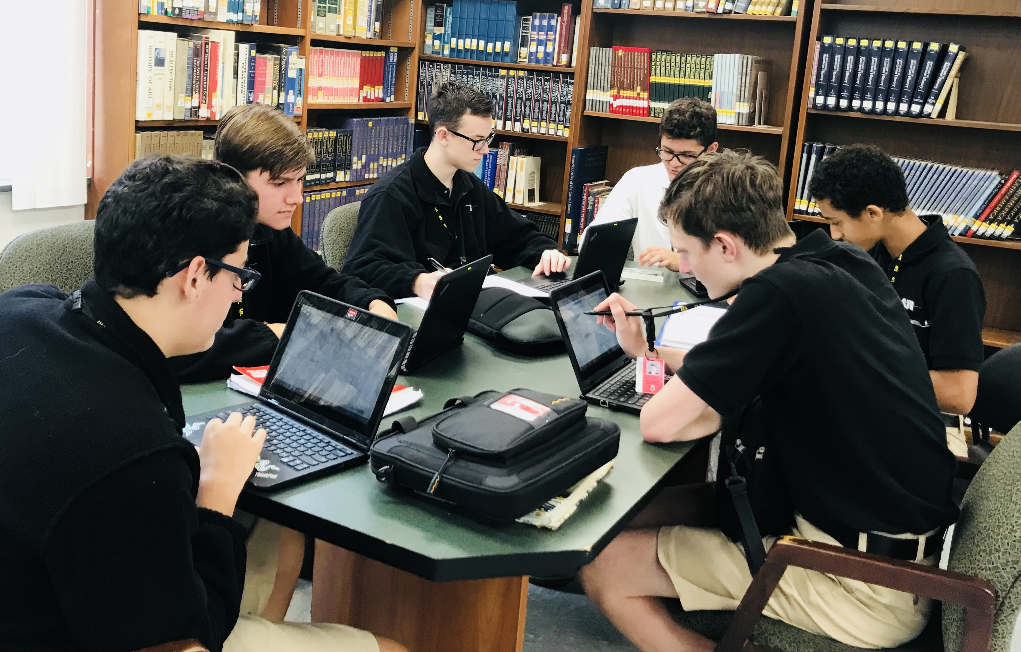 Students Studying in Library - Saint John Vianney High School